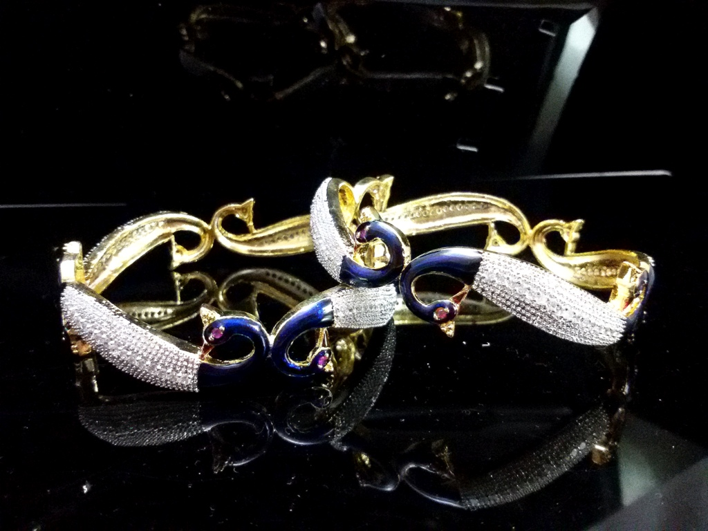 Daphne AD studded white Gold Plated Peacock Bangles